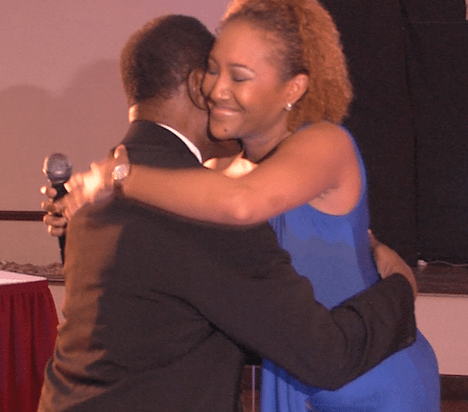 Betty Payne giving the birthday boy Dick  Stoute a hug after  her song to him.