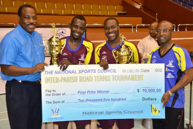 (Team St Lucy) - Kerry Francis (second right) and Curtis Jones won the 2016  NSC Inter-parish road tennis championship and collected their prizes from Minister of Sports Stephen Lashley (right) and Brian Hennis (left) of Beacon Insurance.