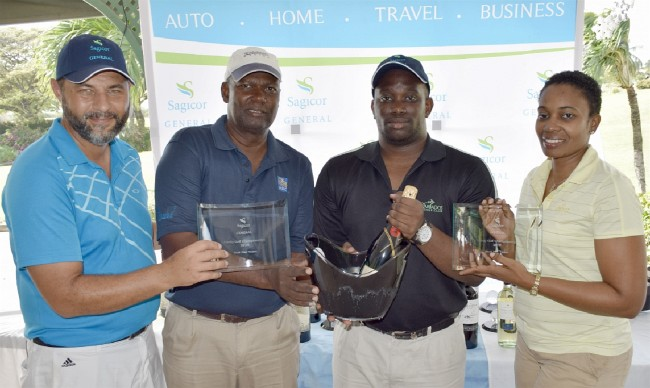 Trenton Weekes and son Phillip were the overall net champions and received prizes from Sagicor's Mark Blakeley (l) and Regina Hoyte.