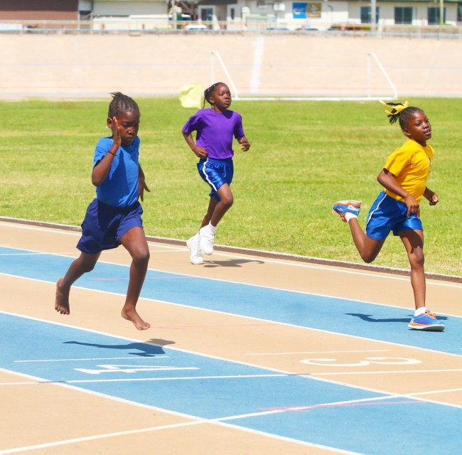 Tyisha Jordan of Blue House edged out Makayla Hawkesworth of Gold House on the line in the under-nine girls 100m.