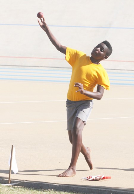 Tyrek Dixon as he throws 44.40 for Yellow House in the under-13 boys cricket ball event.