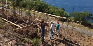 Adventist volunteers building a new home for a family on the island of Dominica.