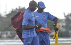 Coaches Vasbert Drakes (left) and Ezra Moseley leaving the field after a training session with the West Indies Women's team.