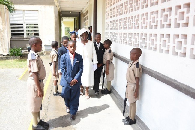 Students going through their reenactment of Queen Elizabeth II visit to open the school in 1966.