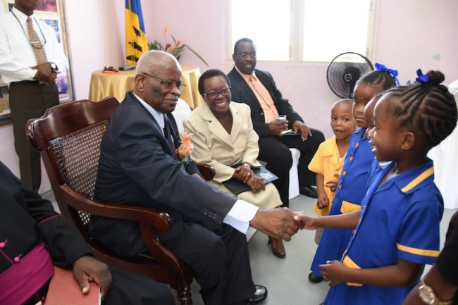Governor General Sir Elliott Belgrave (left) greeting delighted students at St Elizabeth Primary as principal Ingrid Prescod (second at left) and Education Officer Lomer Rock (third at left0 look on.
