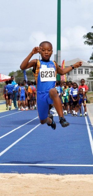 Joshua Moore not only dominated the Boys U9 long Jump with this leap of 3.25m but went on to top his division and take victor ludorum honours.