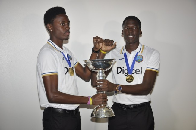 The Barbadian members of the team Shamar Springer (left) and Chemar Holder  pose with the World Cup trophy.
