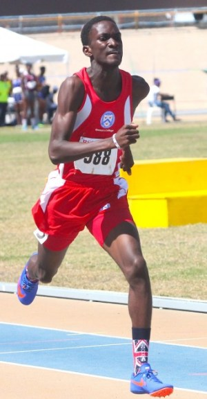 Antonio Hoyte-Small of Queen's College raced against the clock and won while breaking Wilan Louis' long- standing record in the under-17 boys 400m.