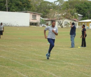 Cameron Cadogan comfortably winning his 200m in a time of 30.84.