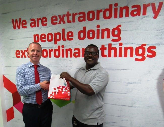 Digicel CEO Conor Looney (at left) presenting taxi operator Adrian Brathwaite with his new Android handset.