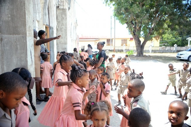 Principal Beverly Parris (hand outstretched) and two teachers supervising the students during the lunch break.