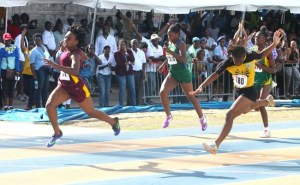 Harrison College's Akayla Morris meant business today as she powered her way to victory in the under-17 girls 100m.