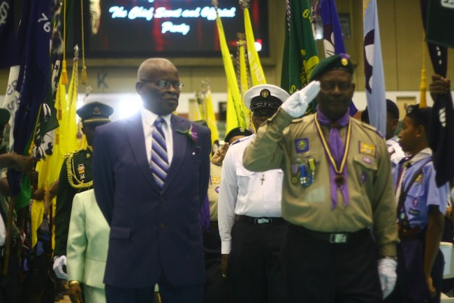 Governor General Sir Elliott Belgrave being escorted by Barbados Boy Scouts.