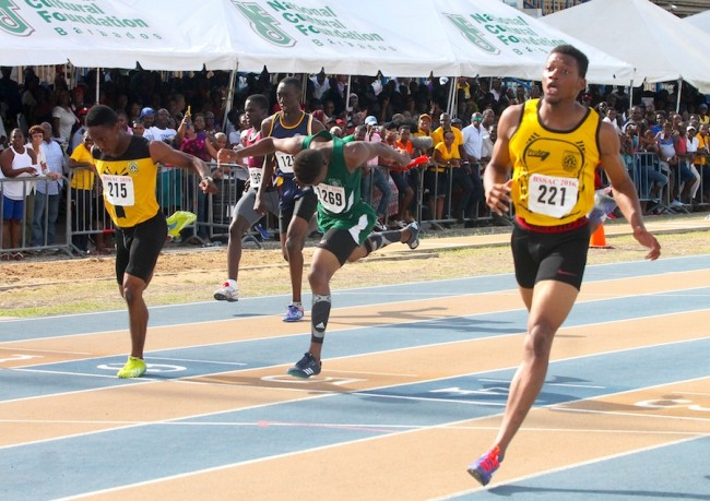 Kevin Briggs (right) of Christ Church Foundation had the final say in the under-20 boys 200 when he crossed the finish line ahead of the field.