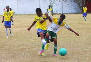 Maleek Payne of Whitehall Football Academy (left) and Reniko Samaru of Parkinson Memorial (left) battling for ball possession in under-13 division.