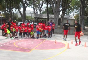 The campers paying close attention on how to dribble during a session today at Harrison College.