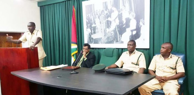 Officer in Charge of the Georgetown Prison Kevin Pilgrim addressing members of the media in the presence of (from left) Public Security Minister Khemraj Ramjattan, Director of Prison Carl Graham and his Deputy Gladwin Samuels.