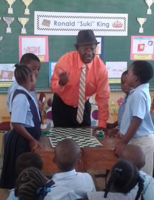 """Ronald """"Suki"""" King interacting with the children."""