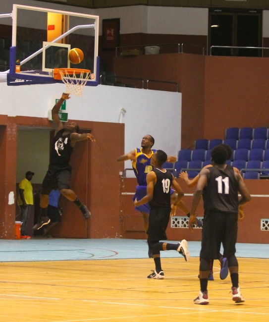 Andrew Ifill of Combined Schools Tridents goes up for another lay-up against Barbados Lumber Company Lakers.