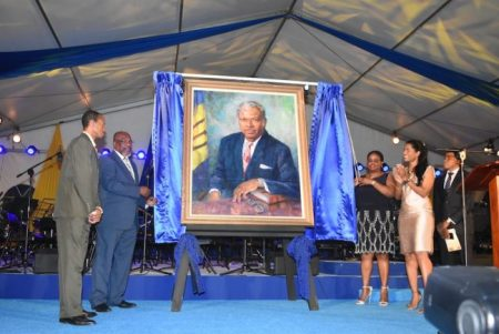 The portrait of Errol Barrow being unveiled by Speaker of the House Michael Carrington (second from left) and Senate President Kerryann Ifill (second at right). Looking on is Senator Esther Byer-Suckoo (right) and fine artist Wayne Branch.