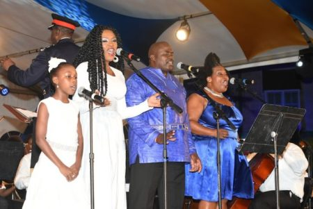From right, singers Paula Hinds, James Leacock, Kareem Clarke and her daughter Trinity performing the 50th Anniversary Song Legends To Legacy, while being backed by the Barbados Mass Choir, Royal Barbados Police Force Band and National Youth Symphony Orchestra.