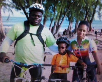 (From left) Quincy Jones, son Kymani, and fiancé Kathy Bradshaw (right) on their bicycles posing for a family picture.