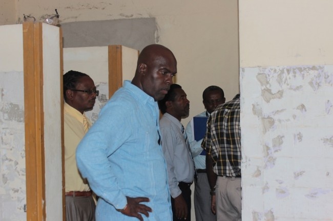 Minister of Transport and Works Michael Lashley having a look at the toilet facilities at the River Terminal.