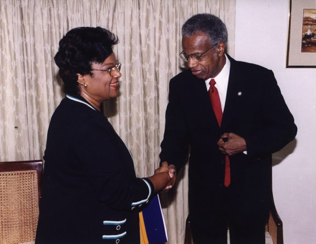 Minister of Foreign Affairs Billie Miller receiving a courtesy call from Sir George Alleyne, director of PAHO.