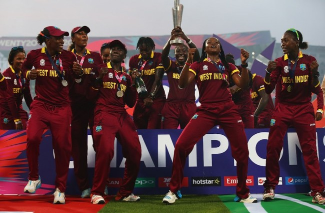 Shaquana Quintyne (second right) celebrating with teammates in India on Sunday. She also won big at the BCA awards on Saturday night.