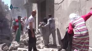 This image from video released by Qasion News Agency on Friday  shows people scrambling through rubble following airstrikes in Aleppo, Syria.