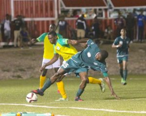 Wales captain Jabar Greene tries his best to stave off a strong challenge from Raheim Sargeant of Barbados Defence Force Sports Programme. (Pictures by Morissa Lindsay)