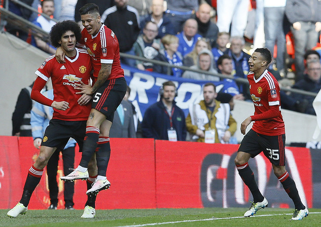 United's Marouane Fellaini, left, United's Marcos Rojo and United's Jesse Lingard, right, celebrate after scoring during the English FA Cup semifinal soccer match between Everton and Manchester United at Wembley stadium in London, Saturday, April 23, 2016.(AP Photo/Kirsty Wigglesworth)
