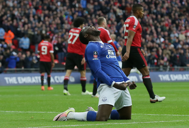 Everton's Romelu Lukaku celebrates after Manchester United's Chris Smalling scored an own goal for Everton's first goal of the game during the English FA Cup semifinal between Manchester United and Everton at Wembley stadium in London, Saturday, April 23, 2016. (AP Photo/Tim Ireland)