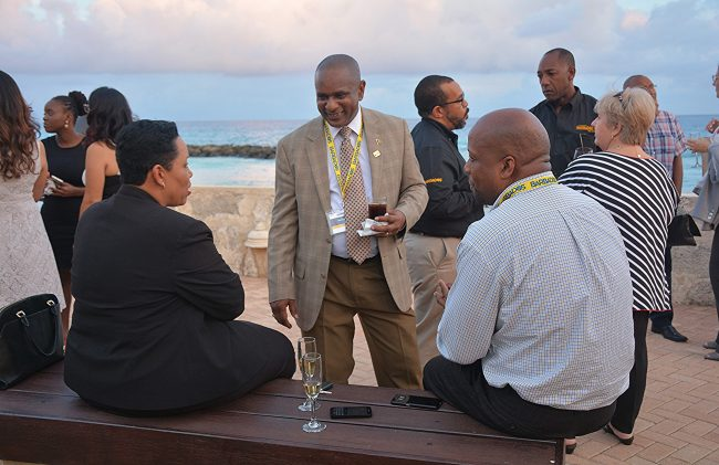 BTMI Chairman, Alvin Jemmott (centre) in conversation with tourism partners.