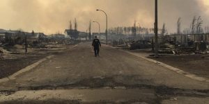 A Mountie surveys the damage on a street in Fort McMurray in this Twitter image posted on Thursday.