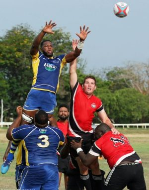Bajan flanker Enrique Oxley being lifted by team-mate Kemar Holder-Edghill (No.3) during a lineout, while Trinidad attempts to intercept the ball.