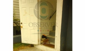Blood splashed across the door of a 61-year-old woman's home after she was reportedly stabbed by her teenaged son.
