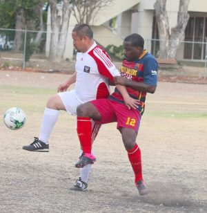 Captain of Royalty Masters Michael Forde (right) locked in battle with Brooklyn Central's midfielder Kevin Moo Young.
