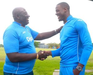 Carlos Brathwaite (right) is greeted by coach Roddy Estwick.
