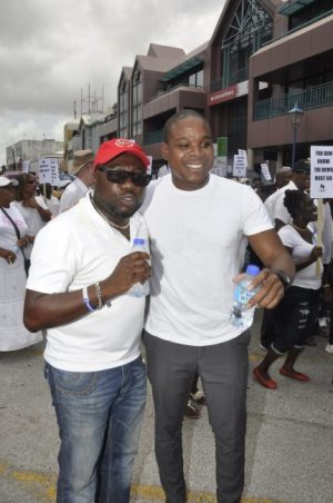 NUPW President Akanni McDowall (right) shares a light moment with St George  South MP Dwight Sutherland.