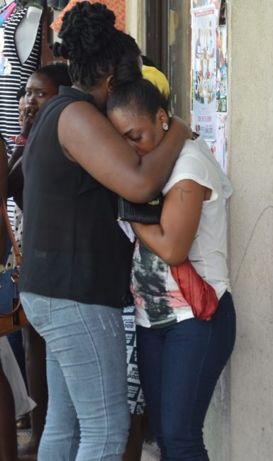 A grieving friend of Melissa Went being comforted at the scene.