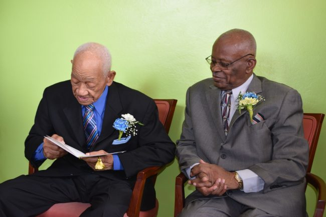 Centenarian Francis Clarke reading his birthday card.