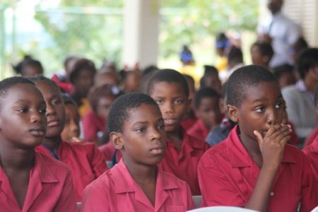 Students at Gordon Greenidge Primary as they listened attentively to the Governor General.