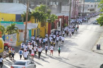 The Chefette Fun Run  participants along Bay  Street, The City, on  their way to Fontabelle.