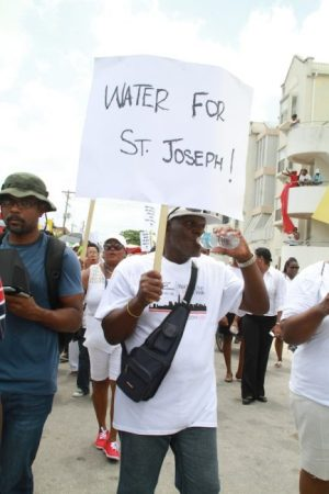 This protester drew attention to the plight of residents in St Joseph.