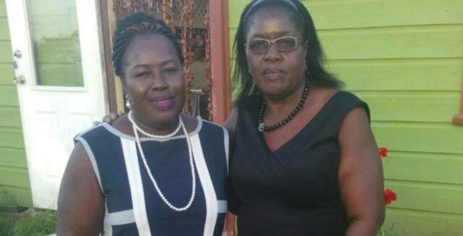 The late Veldene Hinds (right), who died at the Queen Elizabeth Hospital last night after being shot in the brain on Sunday night, and her sister Jacky Hinds in happier times.
