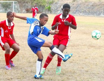 Jevonte Blackett of West Terrace does well to defend against St Stephen's strikers who were always on the attack.