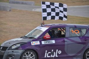 Kyle Catwell takes the chequered flag.