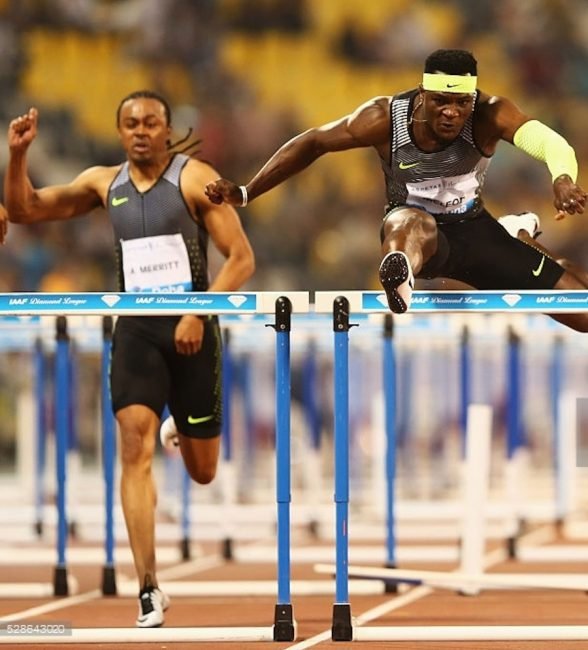 Omar McLeod (right) storming to victory in the 110m hurdles.