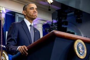 President Barack Obama pauses while speaking in the briefing room of the White House in Washington on Friday.